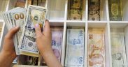 Turkish lira plunges after Erdogan ousts Central Bank Governor 22