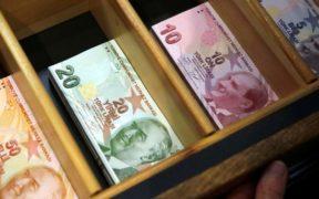 Turkish lira falls to record low following Erdogan's call for rate cut 25